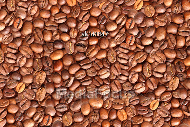 Abstract Background With Pile Of Roasted Black Coffee Beans. Close-up. Studio Photography Stock Photo