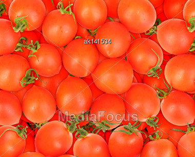 Abstract Background Of Ripe Red Tomatos. Close-up. Studio Photography Stock Photo