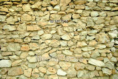 Abstract Background Of Stone Wall. Close-up. Outdoor Photography Stock Photo