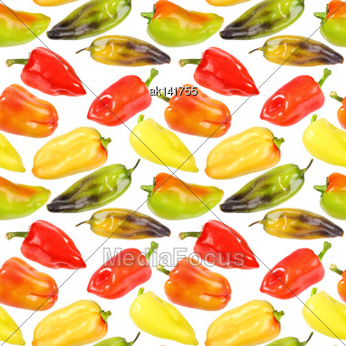 Abstract Seamless Pattern Of Multicolored Fresh Peppers. Isolated On White Background. Close-up. Studio Photography Stock Photo