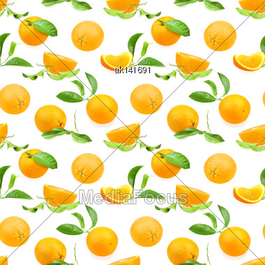 Abstract Seamless Pattern With Oranges-fruits And Green Leafs On White Background. Close-up. Studio Photography Stock Photo
