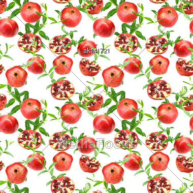 Abstract Seamless Pattern With Red Pomegranates And Green Leafs. Isolated On White Background. Close-up. Studio Photography Stock Photo