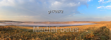 Autumn Landscape, Salt Lake On A Background Of Hills And Sky Stock Photo