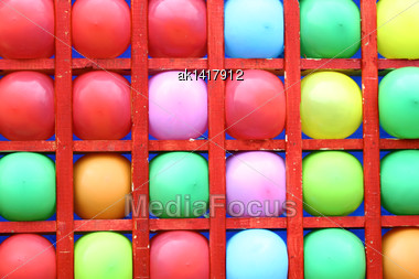 Background Of Motley Balloons-darts Streets-attraction. Close-up. Outdoor Photography Stock Photo