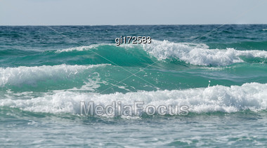 Beautiful Tidal Waves Against The Sky. Seascape Stock Photo