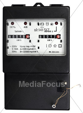 Black Mechanical Two-tariff Electric Meter. Isolated On White Background. Studio Photography Stock Photo