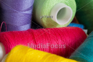 Bobbins With Threads Of Different Colors, Close-up Stock Photo
