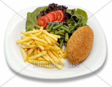 Chicken Cutlet With French Fries And Vegetables. Shooting From The Top On A Sheet Of White Plastic Stock Photo