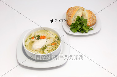Chicken Noodle Soup And Bun With Sesame Seeds And Herbs Stock Photo