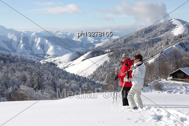 Couple Of Mature Skiers Stock Photo