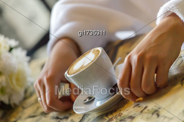 Cup Of Coffee And A Spoon In Bride Stock Photo