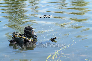 Diver In Equipment, With Underwater Camera Performs A Search Stock Photo
