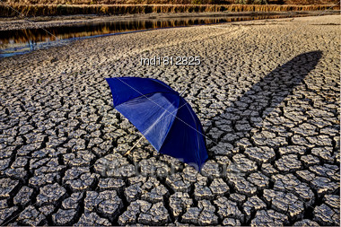 Dry River Bed Cracked Soil Umbrella Canada Drought Stock Photo
