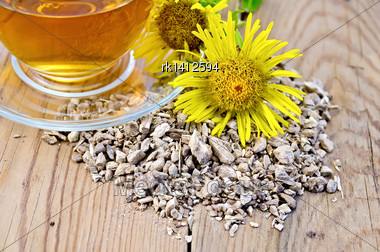 Elecampane Root, Fresh Yellow Flower Elecampane, Tea In A Glass Cup On A Wooden Boards Background Stock Photo