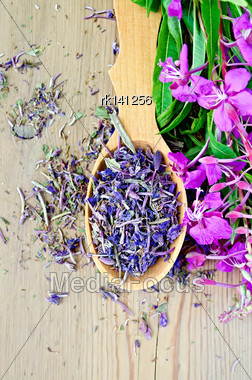 Fireweed Flowers Fresh And Dry In A Wooden Spoon On A Wooden Boards Background Stock Photo