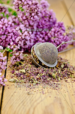 Flowers Fresh And Dry Oregano In A Metal Strainer On A Wooden Boards Background Stock Photo