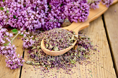Flowers Fresh And Dry Oregano In A Spoon On A Wooden Boards Background Stock Photo