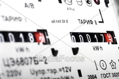 Gauge Of Black Mechanical Two-tariff Electric Meter. Studio Photography Stock Photo