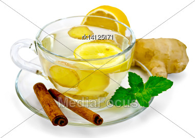 Ginger Tea In A Glass Cup, Lemon, Cinnamon, Ginger, Mint Isolated On White Background Stock Photo