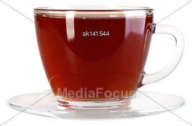 Glasses Cup And Saucer With Black Tea. Isolated On White Background. Close-up. Studio Photography Stock Photo