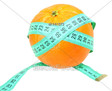 Green Measure-tape On Orange Tangerine As Concept For Dieting. Isolated On White Background. Close-up. Studio Photography Stock Photo