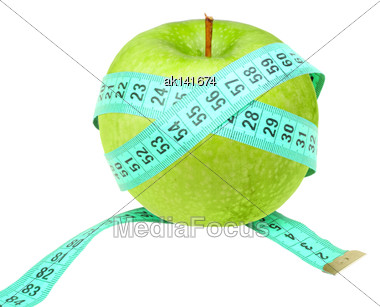 Green Measure-tape On Raw Apple As Concept For Dieting. Isolated On White Background. Close-up. Studio Photography Stock Photo