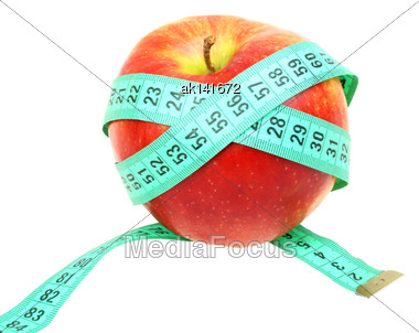 Green Measure-tape On Red Apple As Concept For Dieting. Isolated On White Background. Close-up. Studio Photography Stock Photo
