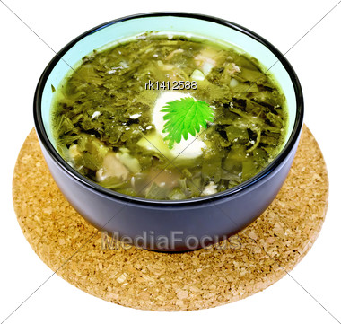 Green Nettle Soup In A Bowl On A Stand Cork Isolated On White Background Stock Photo