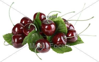 Heap Of Artificial Several Cherries With Leafs. Isolated On White Background. Close-up. Studio Photography Stock Photo