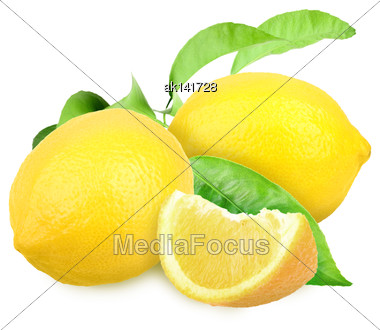 Heap Of Fresh Yellow Lemons With Green Leaf. Placed On White Background. Close-up. Studio Photography Stock Photo