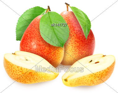 Heap Of Fresh Yellow-orange Pears With Green Leaf. Placed On White Background. Close-up. Studio Photography Stock Photo