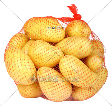 Heap Of Yellow Raw Potatos In Red String Bag. Isolated On White Background. Close-up. Studio Photography Stock Photo