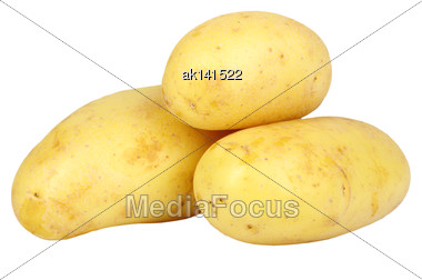 Heap Of Yellow Raw Potatos. Isolated On White Background. Close-up. Studio Photography Stock Photo