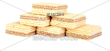 Heap Of Yellow Sweet Chocolate Waffles. Isolated On White Background. Close-up. Studio Photography Stock Photo