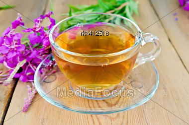 Herbal Tea In A Glass Cup, Fresh Flowers Fireweed On A Wooden Boards Background Stock Photo