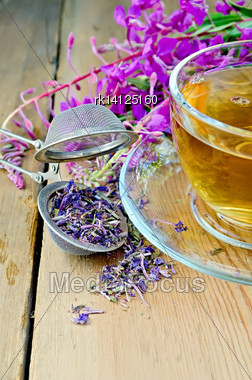 Herbal Tea In A Glass Cup, Metal Sieve With Dry Flowers Fireweed, Fireweed Fresh Flowers On A Wooden Board Stock Photo