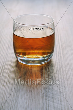 Hot Tea In A Glass, On A Wooden Table, In Backlight Stock Photo