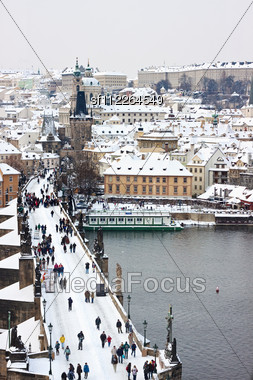 Karlov or charles bridge in Prague in winter Stock Photo