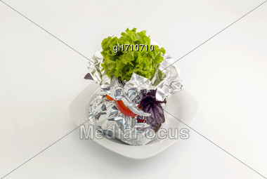 Meat, Vegetables, Fish Baked In Aluminum Foil And Decorated With Fresh Herbs. On A White Plate Close-up Stock Photo