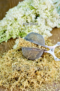 Metal Sieve With Dried Flowers Of Meadowsweet, A Bouquet Of Fresh Flowers Of Meadowsweet On A Wooden Boards Background Stock Photo