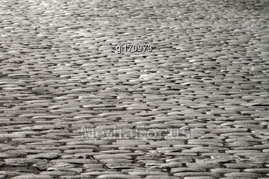 Old Paving Stones Illuminated By Moonlight. Abstract Background Stock Photo