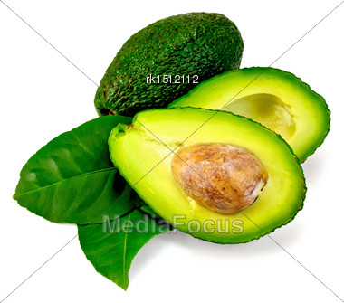 One Whole And One Cut In Half Avocado, Two Green Leaves Isolated On White Background Stock Photo