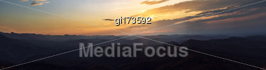 Panorama. Sunset Sky Above The Autumn Mountains Stock Photo