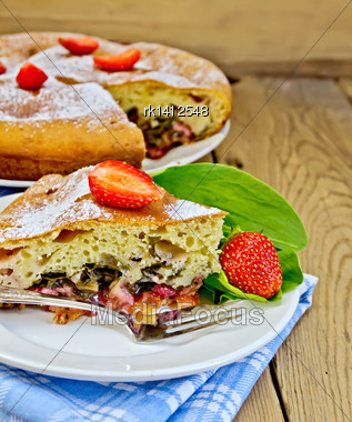 Piece Of Sweet Cake With Strawberries And Sorrel, Napkin, Fork On The Background Of Wooden Boards Stock Photo