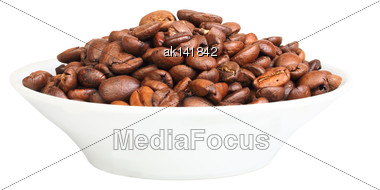 Pile Of Roasted Black Coffee Beans On Plate. Isolated On White Background. Close-up. Studio Photography Stock Photo