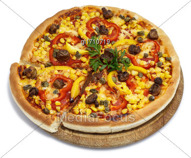 Pizza With Corn, Mushrooms And Sweet Pepper On A Round Wooden Board. View From Above Stock Photo