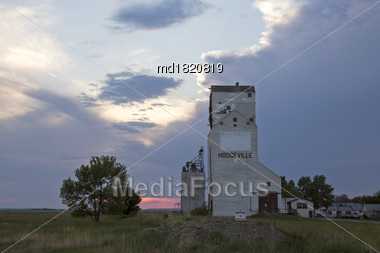 Prairie Storm Clouds In Saskatchewan Canada Grain Elevator Stock Photo