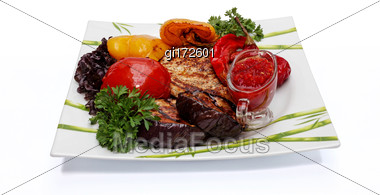 Prepared Beef Steak With Vegetable Decoration, Close-up On A White Background Stock Photo