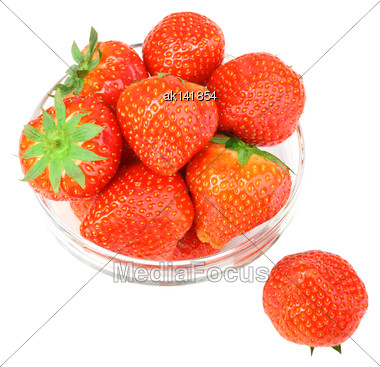 Red Fresh Strawberries With Green Leafs In Transparent Plate. Isolated On White Backdrop. Close-up. Studio Photography Stock Photo