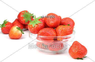 Red Fresh Strawberries With Green Leafs In Transparent Plate. Placed On White Backdrop. Close-up. Studio Photography Stock Photo